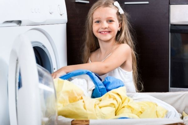 A young girl washing clothes