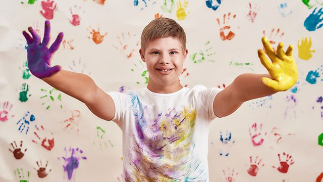 A special needs boy painting